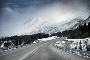 Scenic highway road trip with snow mountain in gloomy at Icefields Parkway photo