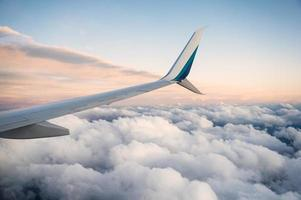 View of wing airplane on cloudy in the sky photo