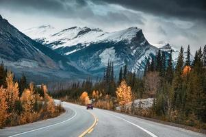 Road trip with Rocky mountains in autumn forest at Banff national park photo