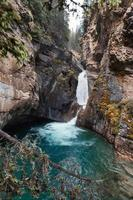 Lower falls flowing in Johnston Canyon at Banff national park photo