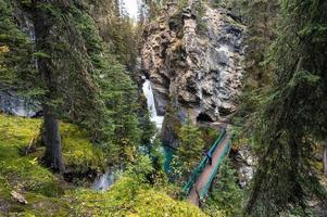 Johnston Canyon waterfall with hike trail in autumn forest at Banff national park photo