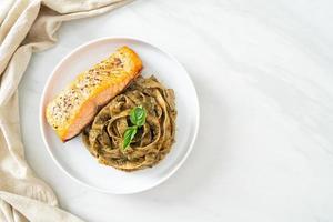 pesto fettuccine spaghetti pasta with grilled salmon fillet photo