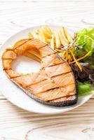 grilled salmon steak fillet with vegetable photo
