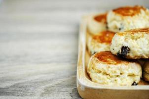 Close up of Scone raisin homemade on wooden table backgrounds photo