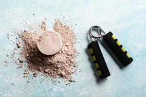 Scoops filled with protein powders for fitness nutrition photo