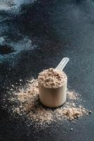 Scoop of Whey Protein in background. Sport nutrition. photo