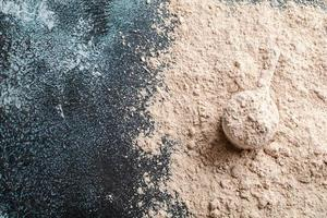 Top view whey protein scoop on dark background, copy space photo