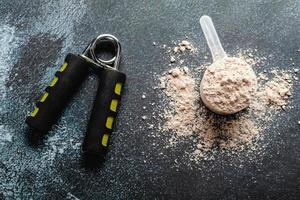 Scoops filled with protein powders for fitness nutrition to start photo