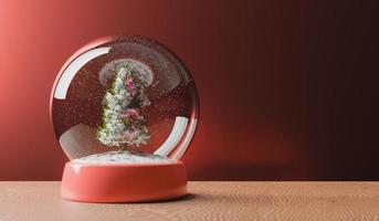 Magical snow globe with Christmas tree on wooden table photo
