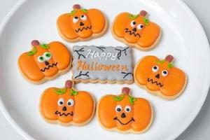 Happy Halloween day with funny Cookies, different Pumpkin biscuits on plate. Trick or Threat, Hello October, fall autumn, Traditional, party and holiday concept photo