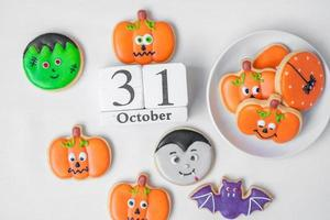 Halloween funny Cookies with 31 October calendar on white background. Trick or Threat, Happy Halloween, Hello October, fall autumn, Festive, party and holiday concept photo