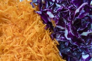 Red cabbage and carrot salad from directly above view as background photo
