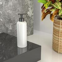 Pump bottles for creams or perfumes that are placed on a pedestal. photo