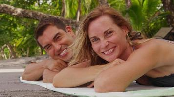Portrait of couple laying on beach. Shot on RED EPIC for high quality 4K, UHD, Ultra HD resolution. video
