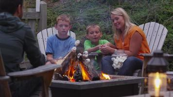 Family roasting marshmallows by outdoor fire. Shot on RED EPIC for high quality 4K, UHD, Ultra HD resolution. video