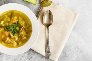 Tasty vegetables and spices soup on a gray concrete background. It can be used as a background photo