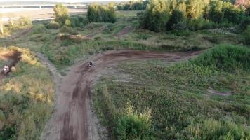 Aerial filming of racing motocross bikes in Tomsk. Siberia, Russia. video