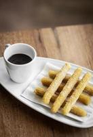 churros con chocolate traditional spanish sweet breakfast set photo