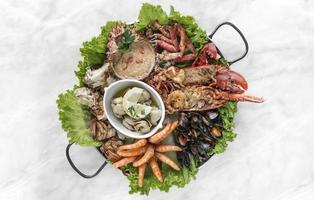 mixed fresh seafood gourmet platter on spanish restaurant table photo