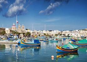 marsaxlokk harbour and traditional mediterranean fishing boats in malta photo