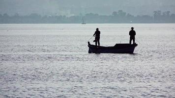 Fishermen Fishing With Rod Fishing On Old Fishing Boat video