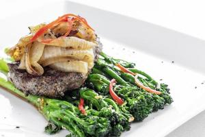 beef steak with caramelized onions and broccoli gourmet restaurant meal photo