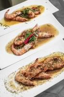 portuguese seafood mixed traditional prawn tapas dishes on restaurant table photo