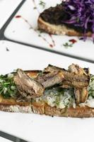 Portuguese tiborna open toast sandwich tapas with sardine and onion garlic photo