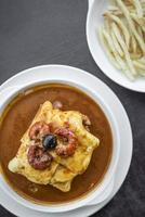 francesinha traditional meat cheese spicy sauce grilled sandwich porto portugal photo