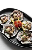 scallops in shell seafood tapas portion in barcelona restaurant spain photo