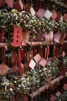 lucky hanging ball decorations in A-ma chinese temple interior macau photo