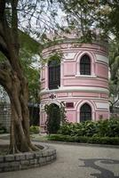 old portuguese colonial architecture building in macau park garden china photo