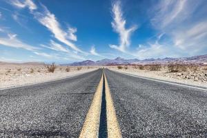 Route 66 in the desert with scenic sky photo