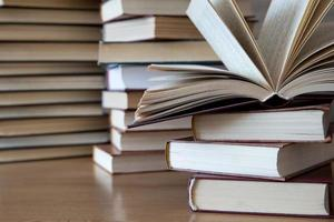 Books on wooden table photo