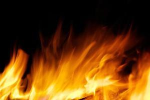 Fire danger on black background photo