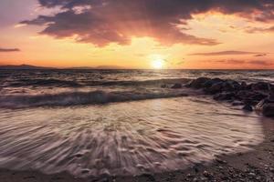 Beautiful sunset over the Aegean sea, Peninsula Kassandra, Halkidiki, Greece photo