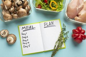 Top view arrangement with meal planning notebook photo