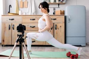 Blogger shoots a video of her workout photo