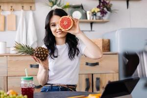 Beautiful girl posing with fruits photo