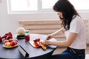 Attractive young woman preparing a delicious, wholesome lunch photo