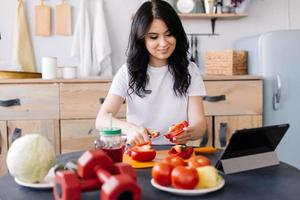 Young, sporty, well-groomed girl prepares useful food after training photo