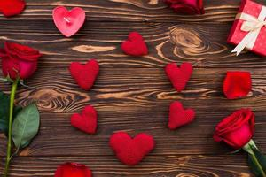 Handmade hearts laid out on a wooden surface photo
