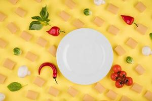 Ingredients for cooking arranged on a yellow background. Concept of italian cuisine photo