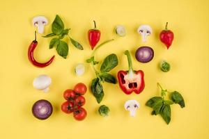 Top view, on a yellow background laid out food. Italian cuisine photo