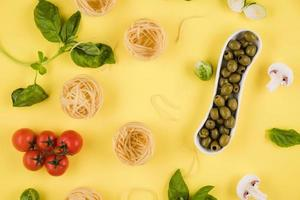 Pasta, basil, olives. Background of products. Top view. photo