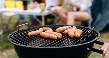 Closeup sausages on the barbecue in the focus. -Image photo