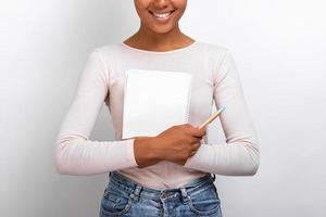 Closeup female hands hugging empty paper notebook and pen, Concept education - Image photo