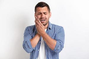 Image of sick man having a stomach ache and touched for his cheek photo