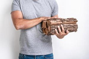 Part of image with male hands holding a firewood photo