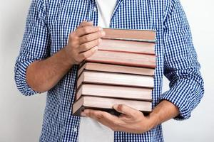 Closeup man holding books in his hands. Back to school.- Image photo